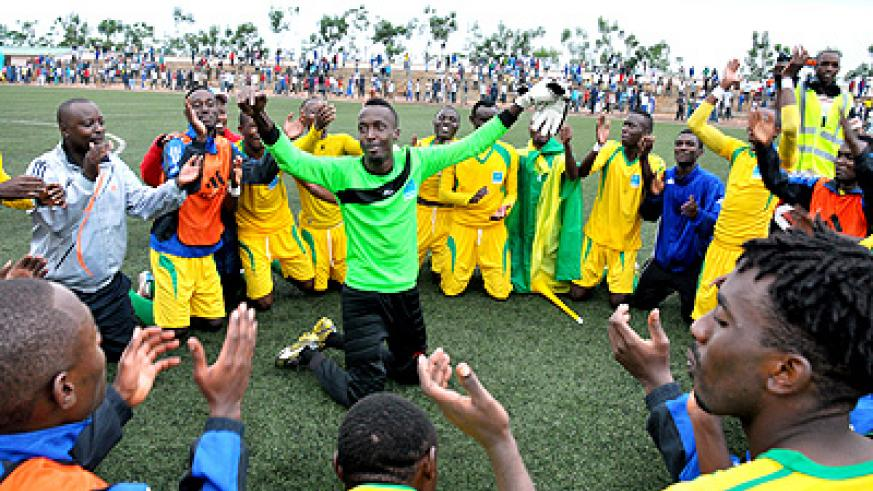 AS Kigali players celebrate after beating Rayon Sports to win the inaugural Super Cup. Saturday Sport / T. Kisambira.