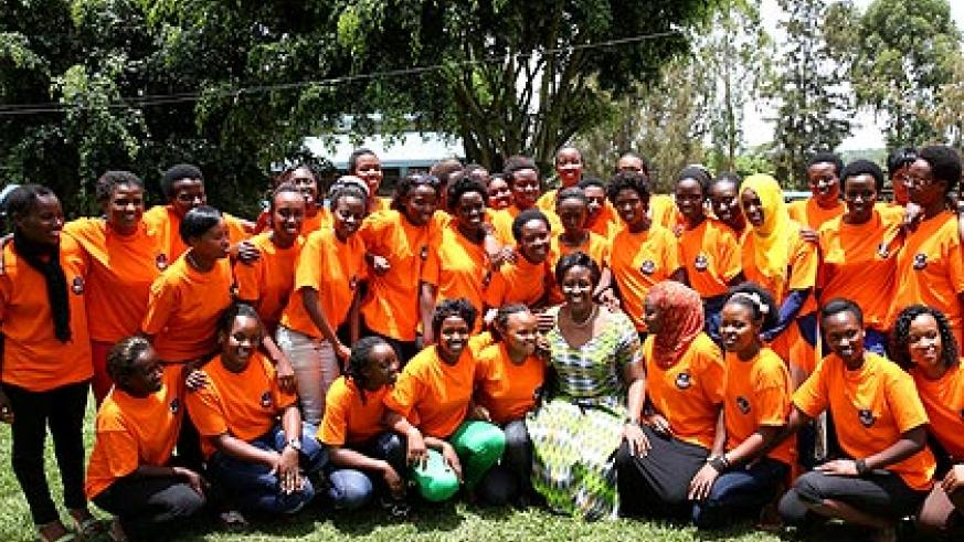 Mrs Kagame and some of the 400 girls under Association of Genocide Survivor Students (AERG) after the  'Now I am Stronger' forum yesterday.  The New Times/ Village Urugwiro
