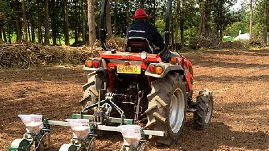 A farmer uses a tractor to plant maize seeds.  Experts at an ongoing forum say mechanisation will transform the agriculture sector.   The New Times/ File.