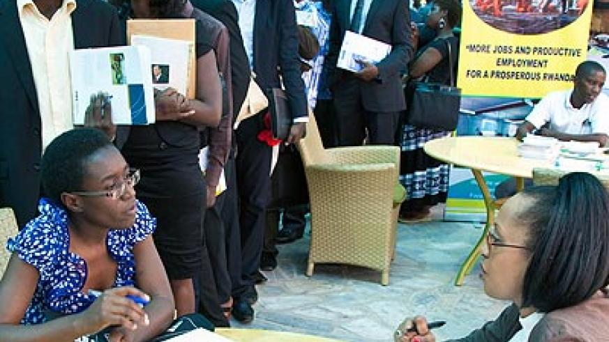 Customer service personnel talk to potential employees during a job fair in Kigali early this year.   The New Times/ File.