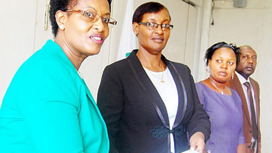 Mukarurangwa (L) hands over to Speaker Mukabalisa as her deputies; Uwimanimpaye and Mukama look on. The New Times/Courtesy