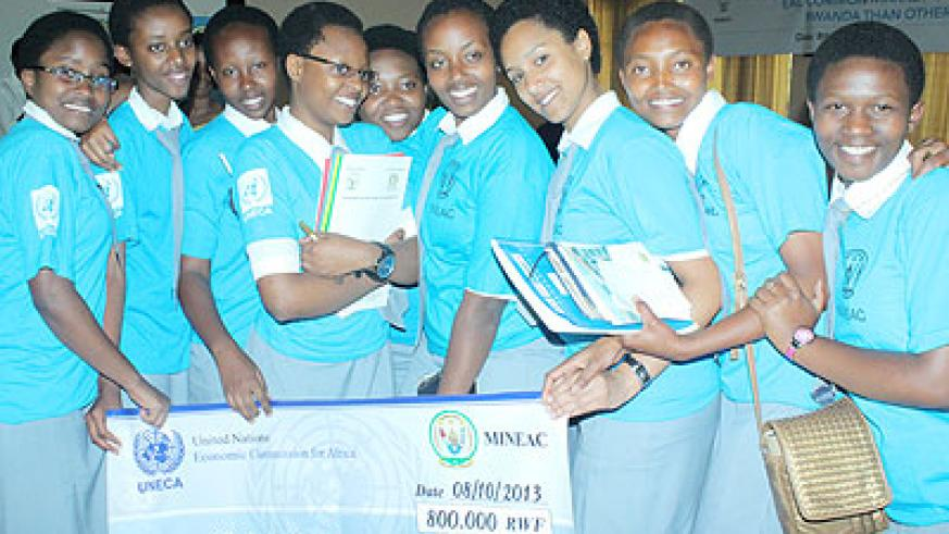 Nyundo school debate team pose with their dummy cheque after they emerged winners. The New Times/Ambroise Agaba