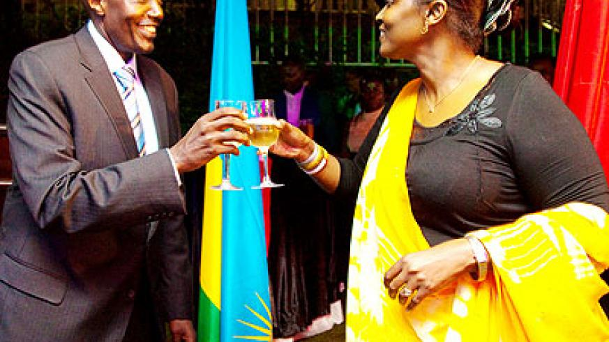 Amb. Kabonero (L) in a toast with Baine on Wednesday. The New Times/ T. Kisambira