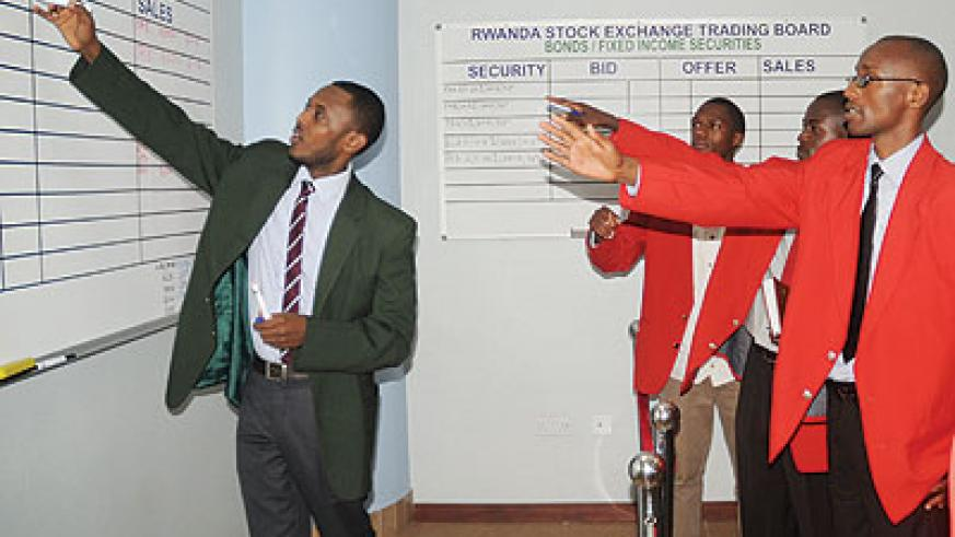 Stock brokers during a trading session early this year. Uchumi joins the local bourse today.
