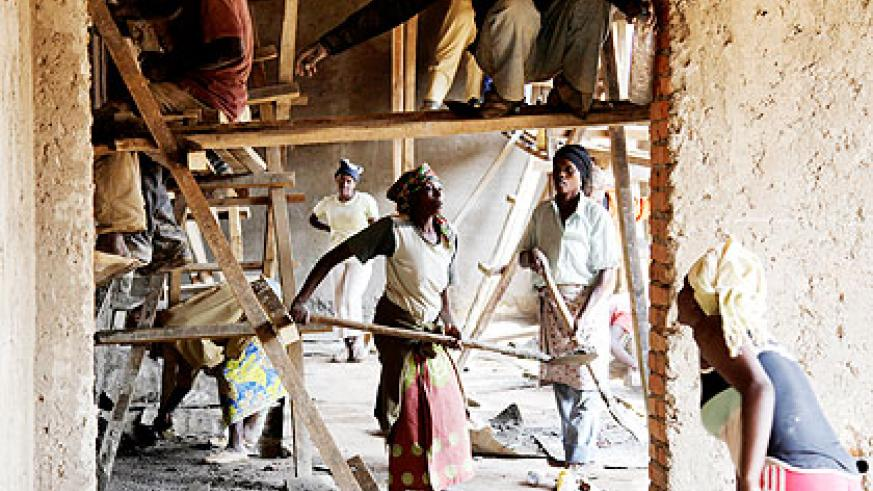 Casual labourers busy on a site.. DN International has left outstanding debts to individuals and franchises.  The New Times/ T. Kisambira.