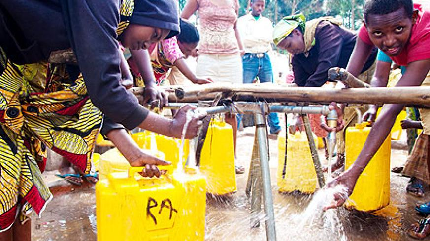 City dwellers draw water from a public source. The New Times/ Timothy Kisambira.