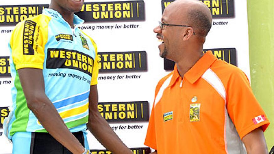 Rwanda Cycling Federation boss Aimable Bayingana (right) congratulates Adrien Niyonshuti during stage five of last year's Tour du Rwanda. Times Sport/ T. Kisambira