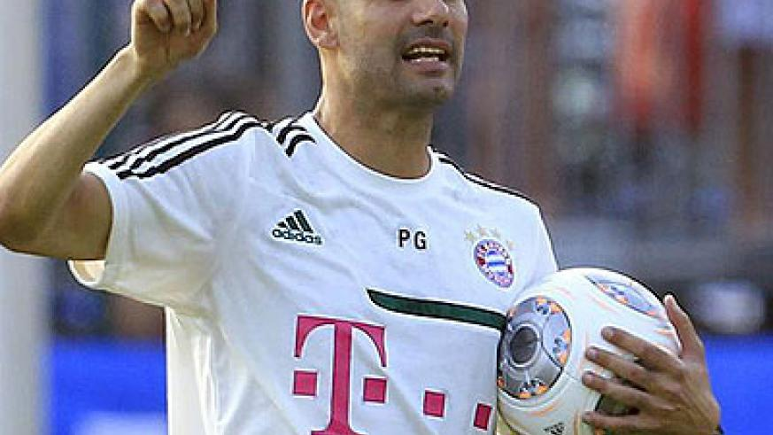 Pep Guardiola makes his point during a training session.  Net photo.