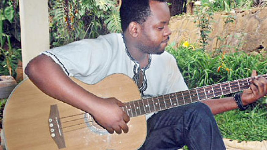 Bac-T plays his guitar. Sunday Times/Moses Opobo