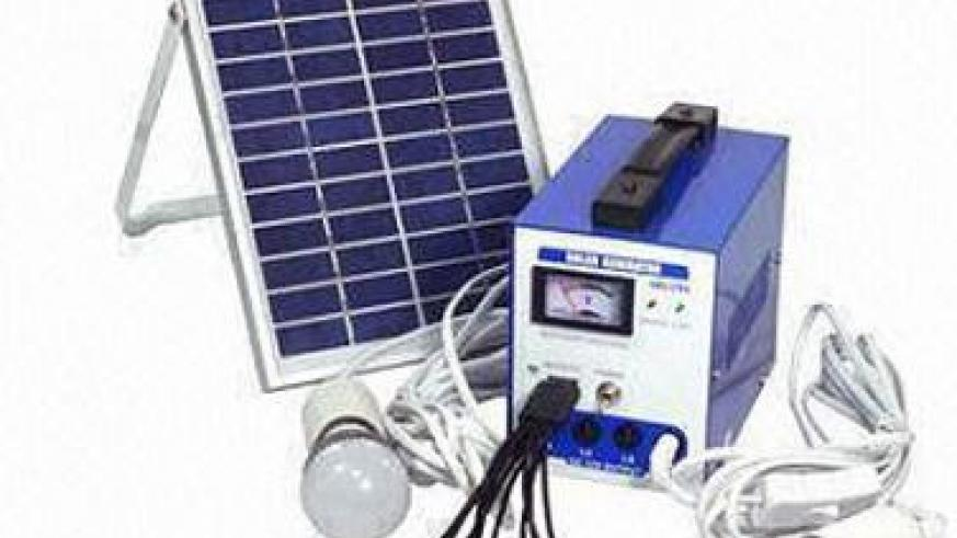 A home solar power system with LED bulb. The New Times / File