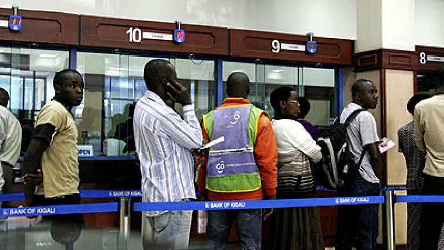 Clients on the queue waiting to be served in a bank. The New Times/File