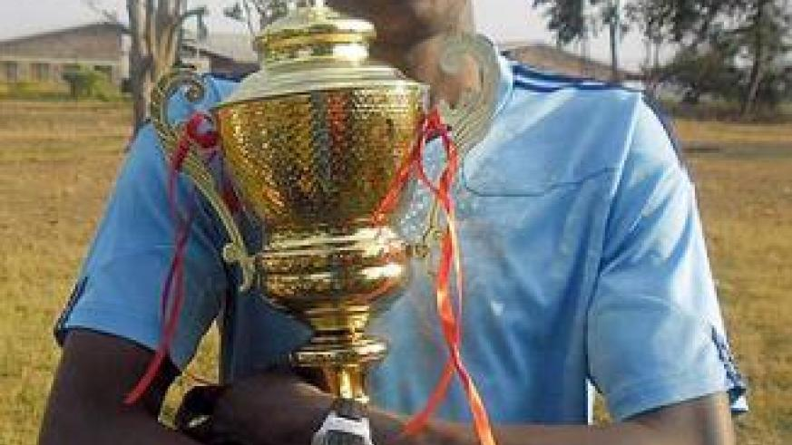 Francois Xavier Ngarambe holding the 2012 Liberation Day tournament trophy. Saturday Sport/ Courtesy.