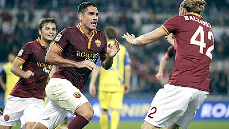 Marco Borriello celebrates scoring the only goal of the game to maintain Roma's 100 per cent start. Net photo