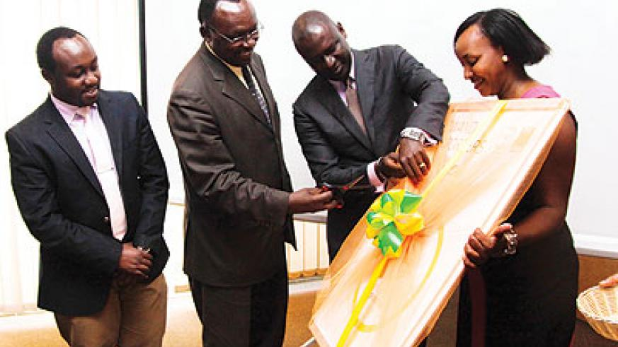 Minister Kanimba (second left) cuts the ribbon to launch the export forum as Mining State Minister Evode Imena looks on. Second right, is PSF chairman Gasamagera. The New Times / John Mbanda