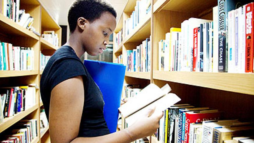A holidaymaker checks out books in the library. The New Times/ File.