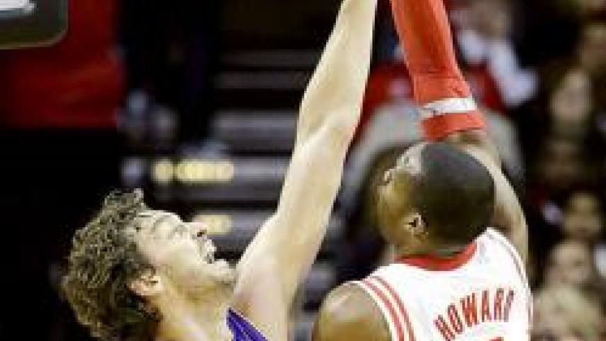 Houston Rocket's Dwight Howard, right, shoots over Los Ageles Lakers' Pau Gasol during the first quarter. Net photo