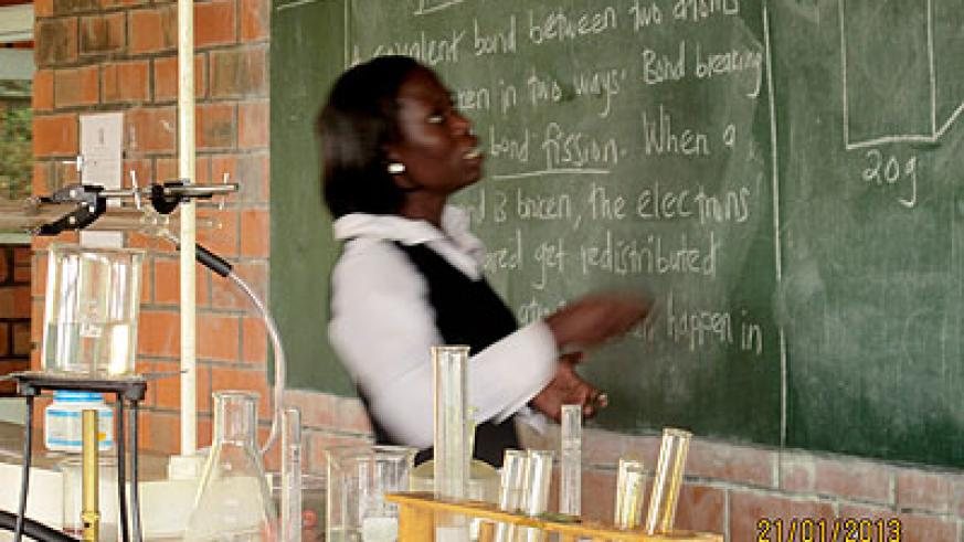 A teacher in the science lab. Education Times/ Allan Brian Ssenyonga.