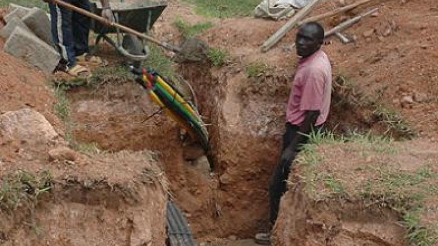 Men laying fibre optic cables. Rwanda is increasing broadband network to ensure Rwandans access cheap and reliable Internet The New Times / Net