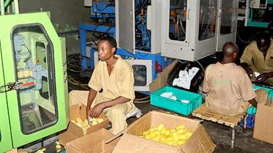 Workers at a factory in Kigali. Members of the private sector have expressed concerns over power outages. The New Times/John Mbanda