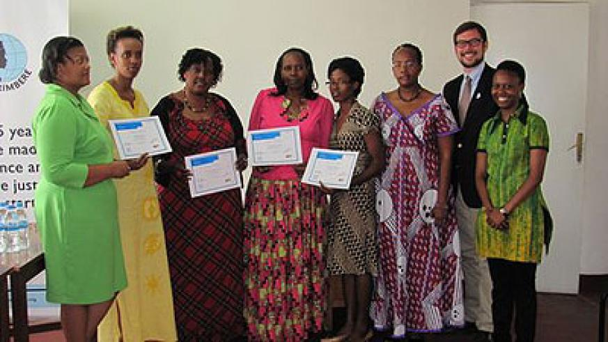 The trainees pose with their certificates after the course. The New Times / Ivan Ngoboka