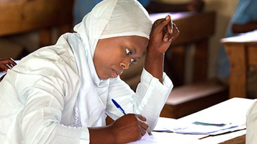A student writing her final exams. Education Times / T. Kisambira.