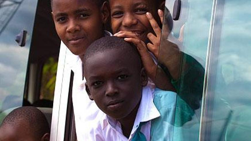 Children in a bus coming from school. The New Times/Timothy Kisambira