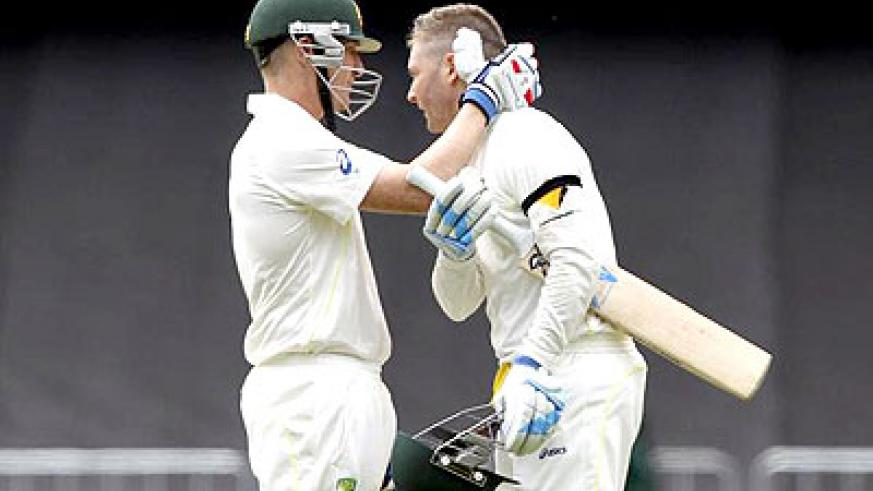 Australia's Brad Haddin congratulates Michael Clarke on scoring a century during the second Ashes Test against England, in Adelaide on Friday. Net photo.