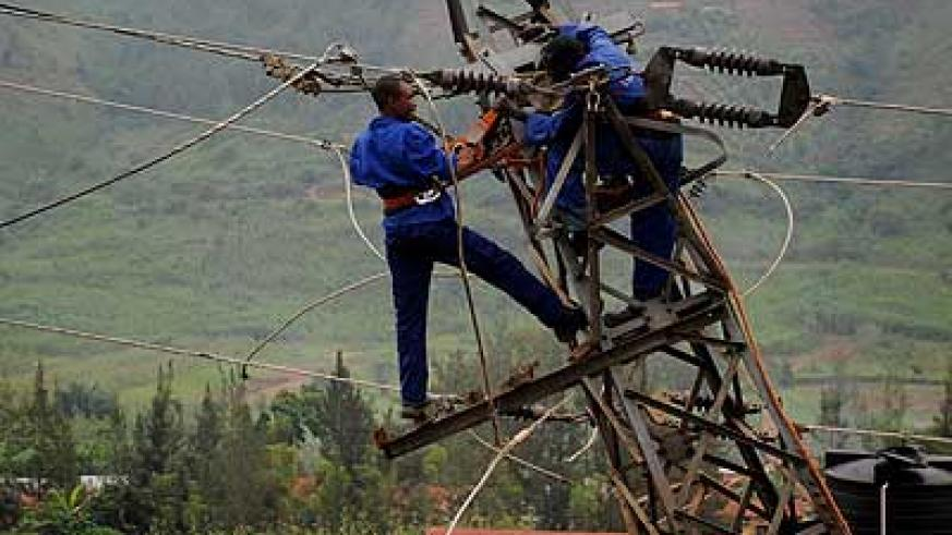 EWSA workers fixing up electric cables.  The New Times/ Timothy Kisambira.