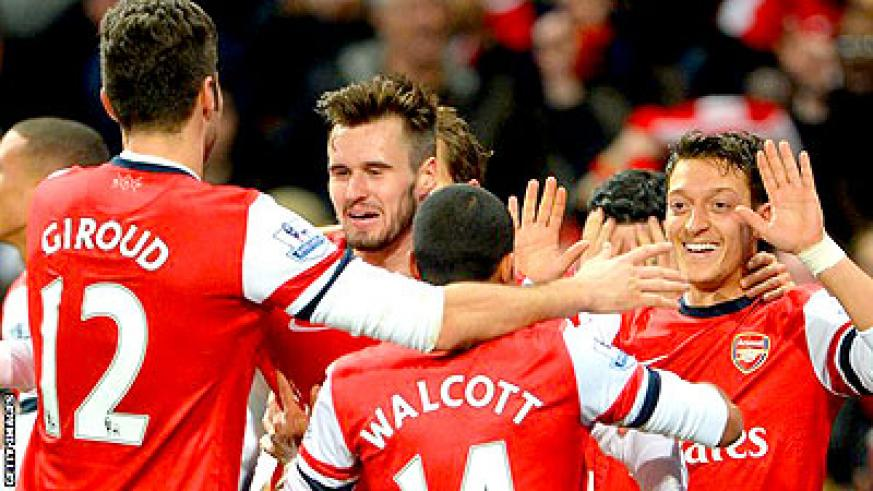 Arsenal celebrate in a previous match. Net photo.