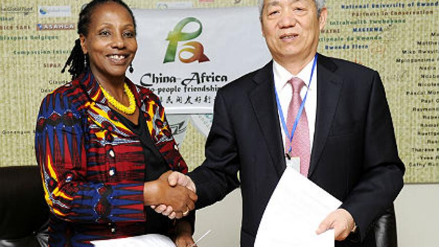 L-R Mrs. Radegonde Ndejuru, DG Imbuto Foundation and HE Ambassador to China Shen Yongxiang during the MoU signing which took place at Imbuto Foundation. The New Times/Courtesy