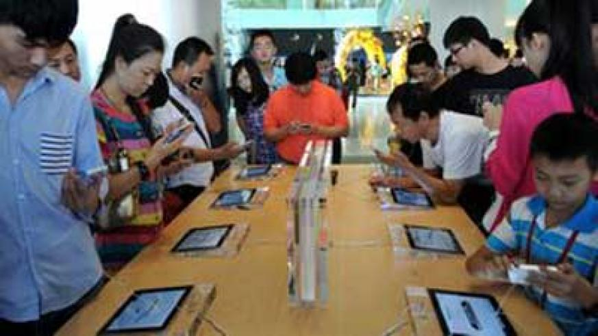 Customers looking at iPhones at an Apple store in China.