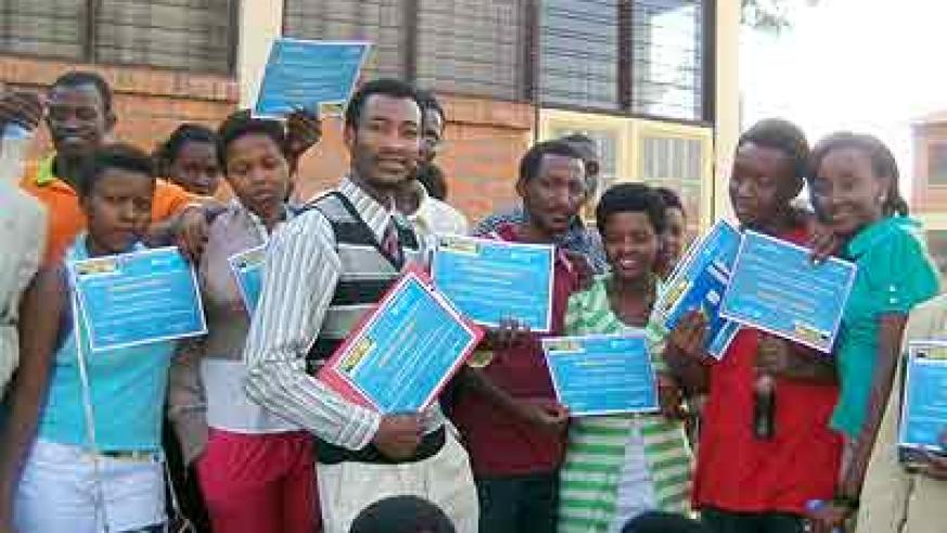 Students showing off their certificates after the training. Education Times/ Susan Babijja.