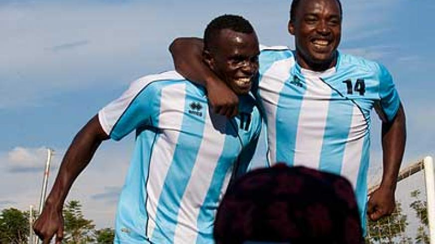 Police FC's strikers Peter Kagabo (L) and Kipson Atuheire (R) celebrate during the 6-0 demolition of another Rubavu team, Etinceles. Saturday Sport / T. Kisambira.
