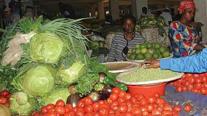 Prices of vegetables like cabbage and tomatoes are stable despite festive season. The New Times / IFile