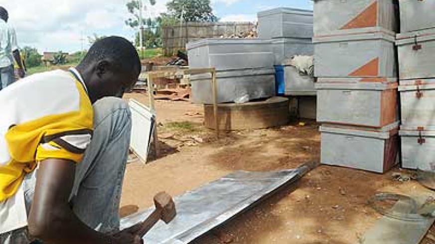 A young man makes traditional metal case. Hanga Umurimo seeks to promote self-employment. The New Times/ T. Kisambira