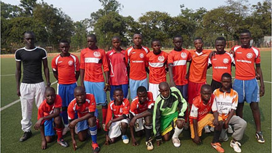 Fabrice Ndayisaba (left) with one of his teams. Saturday Sport / Courtesy