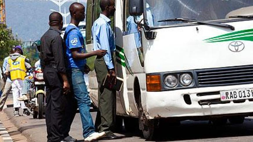 Passengers board a bus. Operators have failed to bring new buses due to financial constraints. Sunday Times/File