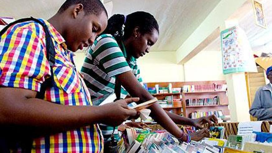 Students buying books at Librarie Caritas ahead of the start of the new term tomorrow. The New Times/Timothy Kisambira