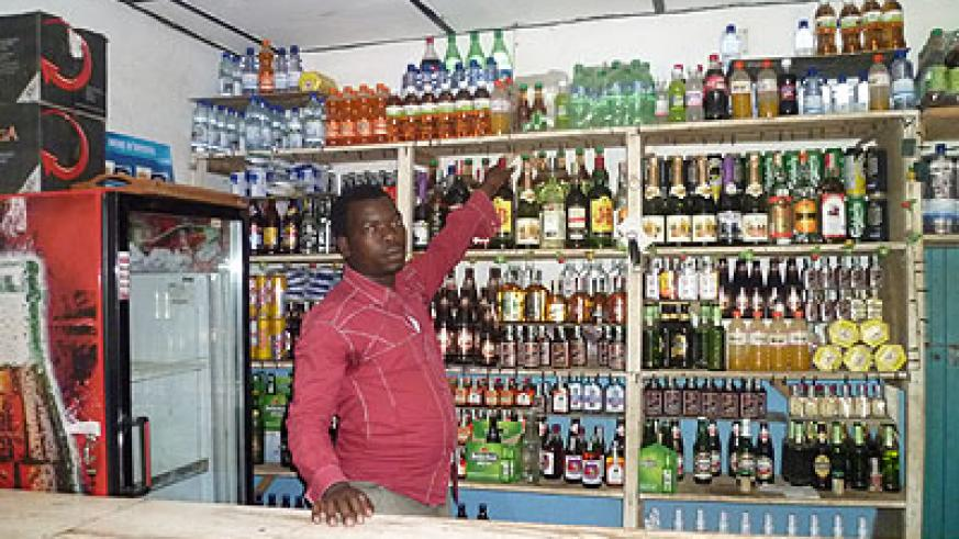 Ngenzi in his bar, one of the three enterprises he owns. The New Times / S. Habimana