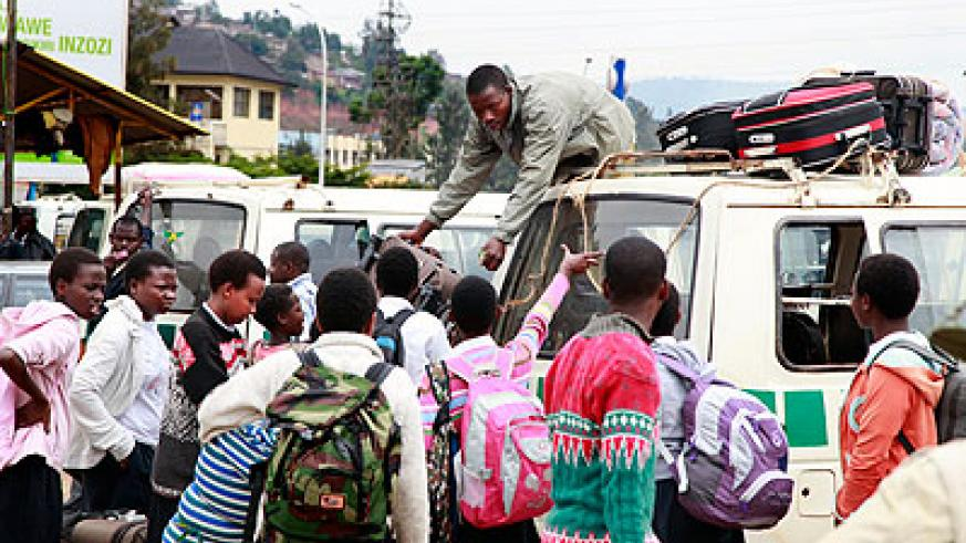 Students heading back to school recently. Education Times / T. Kisambira