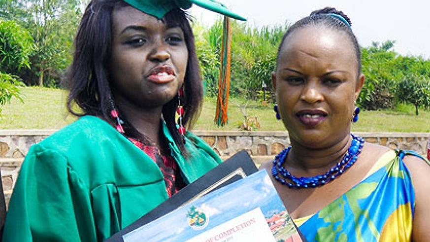 Raissa Tumukunde, 20, and her guardian after the graduation yesterday. One hundred twenty-five orphans, mainly of the 1994 Genocide against the Tutsi, graduated at Agahozo-Shalom Village in various disciplines. . The New Times/ Collins Mwai.