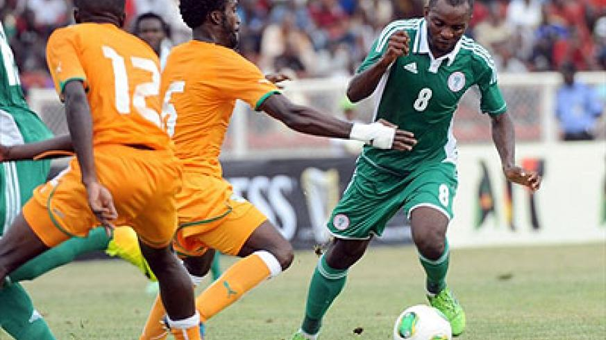 Sunday Mba (R) played key role as Nigeria beat archrival Ivory Coast enroute to 2014 CHAN finals where the reigning African champion are favourites.  Net photo