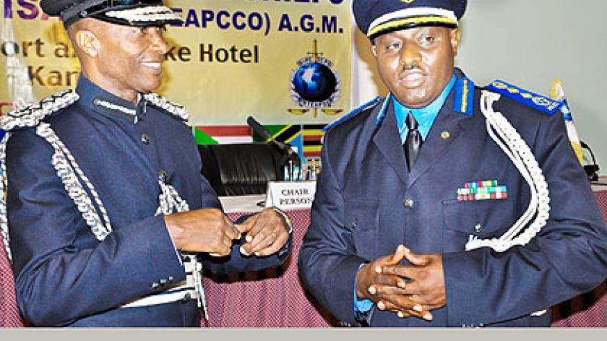 Uganda's IGP Kale Kayihura (L) chats with IGP  Gasana at a past EAPCCO meeting in Kampala.   The New Times/ File.