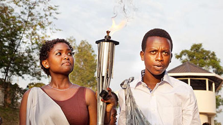 Children carry the Kwibuka Flame. The flame is making a tour of the country ahead of the 20th anniversary of the Genocide against the Tutsi. The New Times/File.