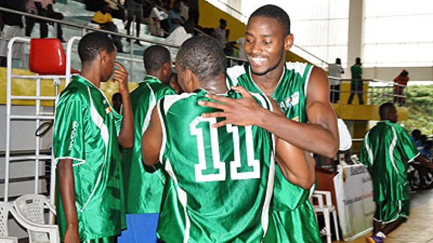 Espoir's forward Olivier Shyaka (facing camera) congratulates his teammate Pascal Karekezi at the end of Game Four of last season's playoff final against KBC.