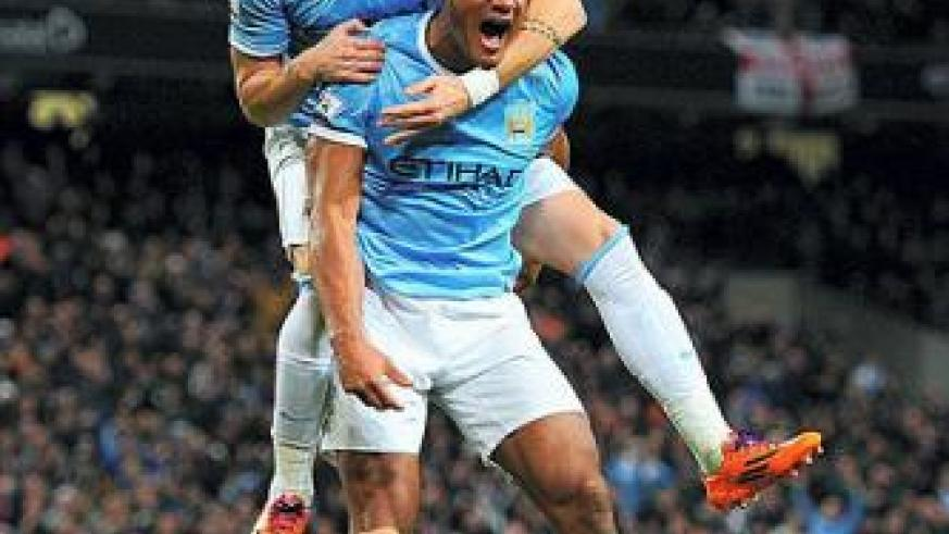 Vincent Kompany and Alvaro Negredo of Manchester City seem tpo be enjoying the moment as their team chaces a unique quadraple. Net photo