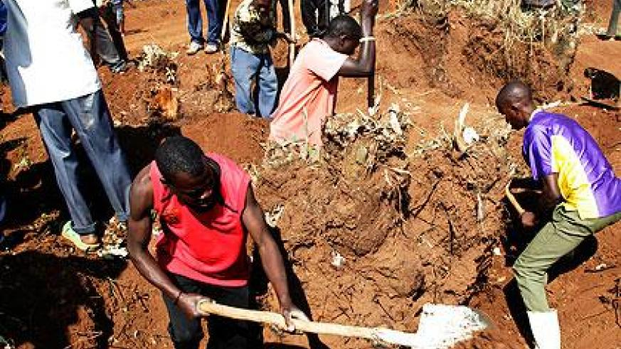 Residents of Bweramvura in Jabana Sector, Gasabo District remove tree stumps to clear a site for the construction of houses for evictees from Tanzania. Sunday Times/ John Mbanda