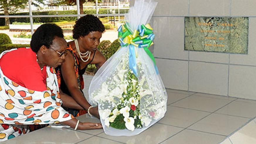 The family of the late Félicité Niyitegeka lays a wreath on her grave last year.  The New Times/  File.
