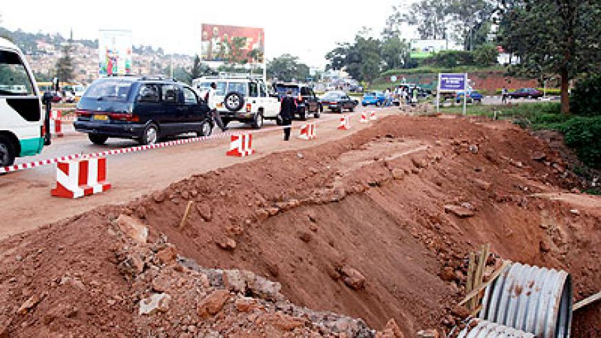 Traffic flow resumed on the road that was damaged by rain. The New Times/ John Mbanda.
