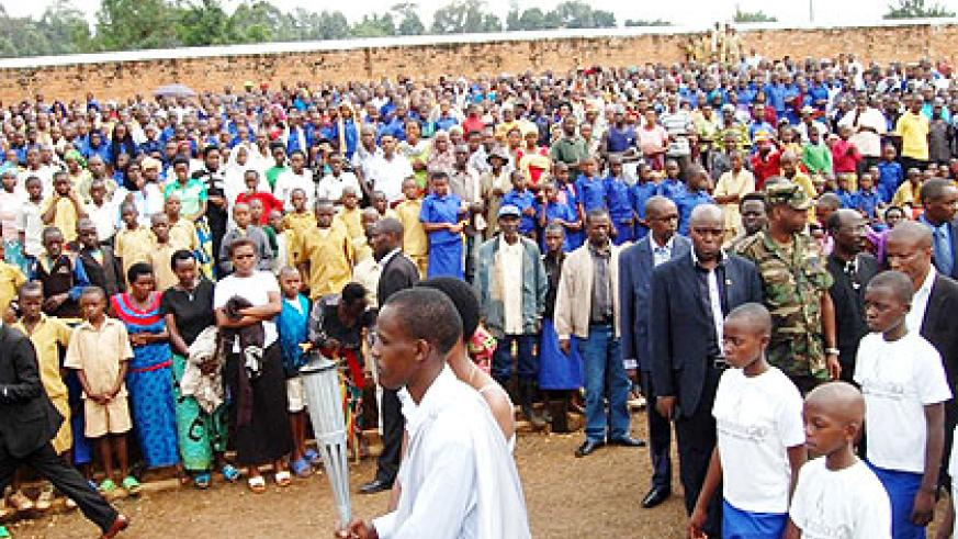 Hundreds of residents pay their respects as the Kwibuka Flame arrives in Rusizo District yesterday. JP Bucyensenge.